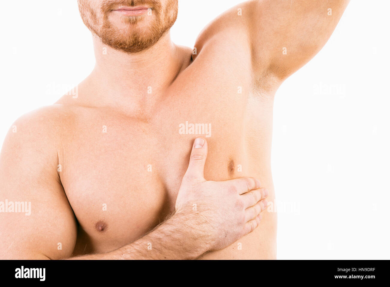 Male torso with focus on armpit - Stock Image