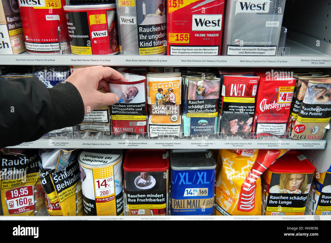 GERMANY - DECEMBER 2016: Shelves with Tobacco packings for rollies in an Kaufland Hypermarket. - Stock Image