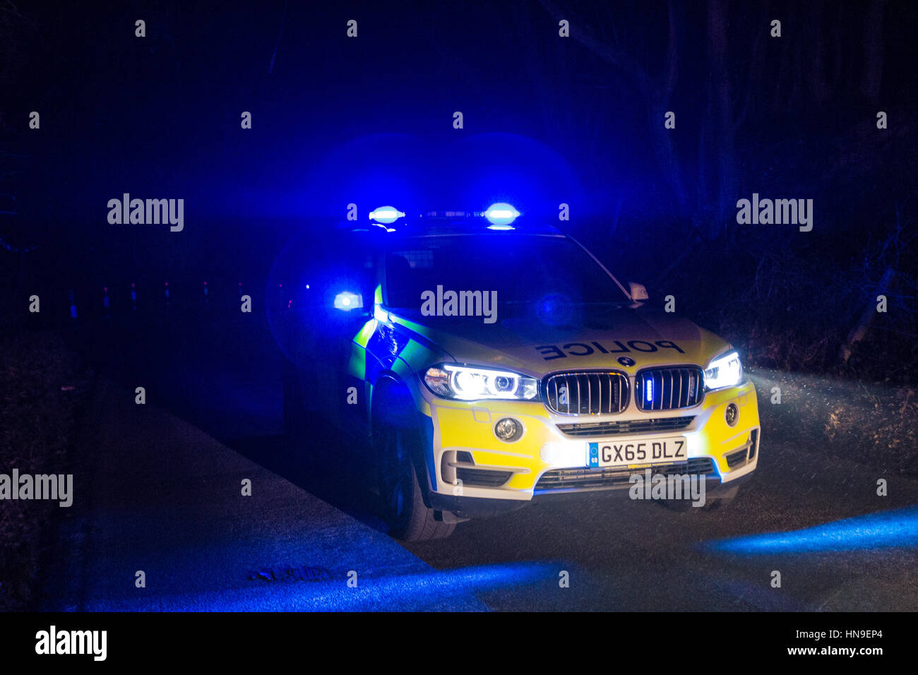 Sussex Police BMW X5 lit up at night. - Stock Image