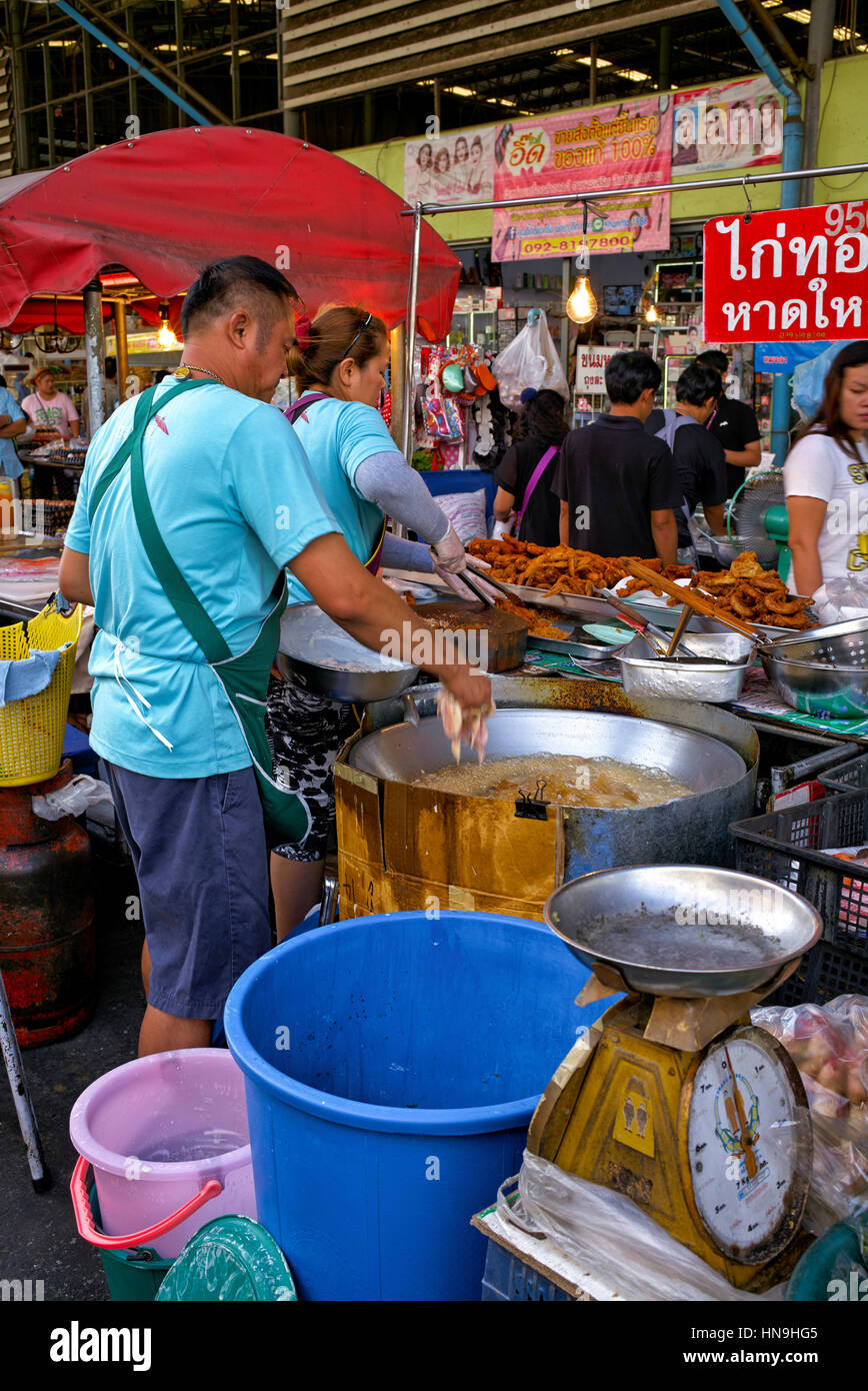 Husband and wife food vendors at a Thailand street food market stall. Thailand Southeast Asia - Stock Image