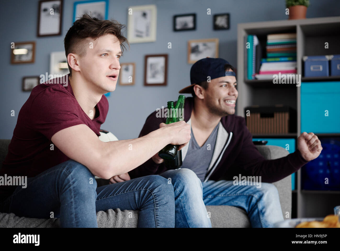 Guys cheering with couple of beers - Stock Image