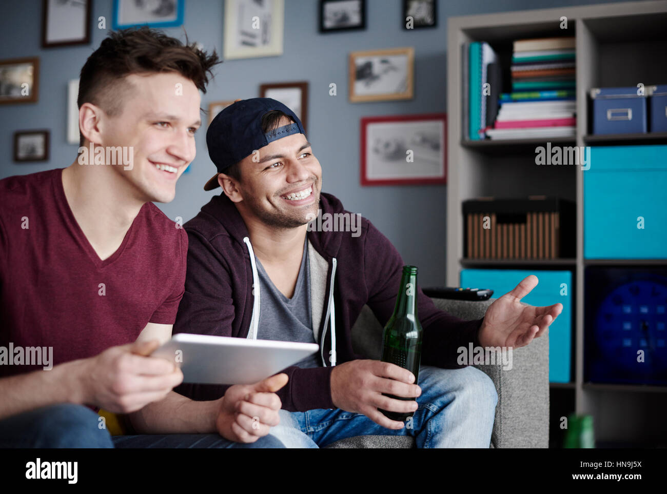 Close up of men with digital tablet and drink - Stock Image