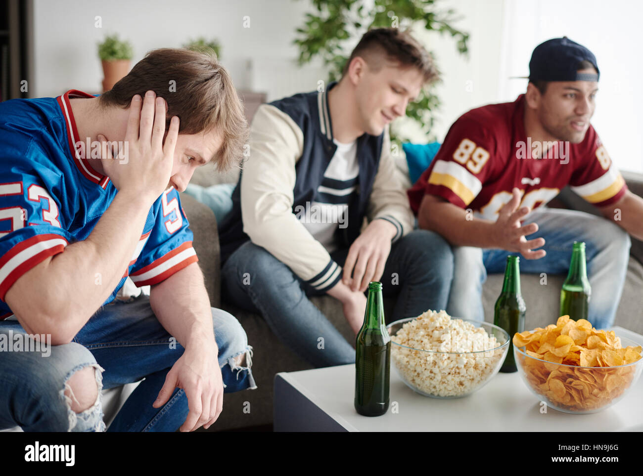 Dissappointed guys can not believe - Stock Image