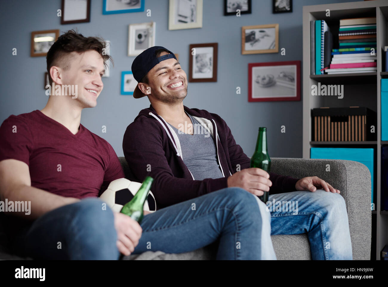 Close up of two men celebrating football game - Stock Image