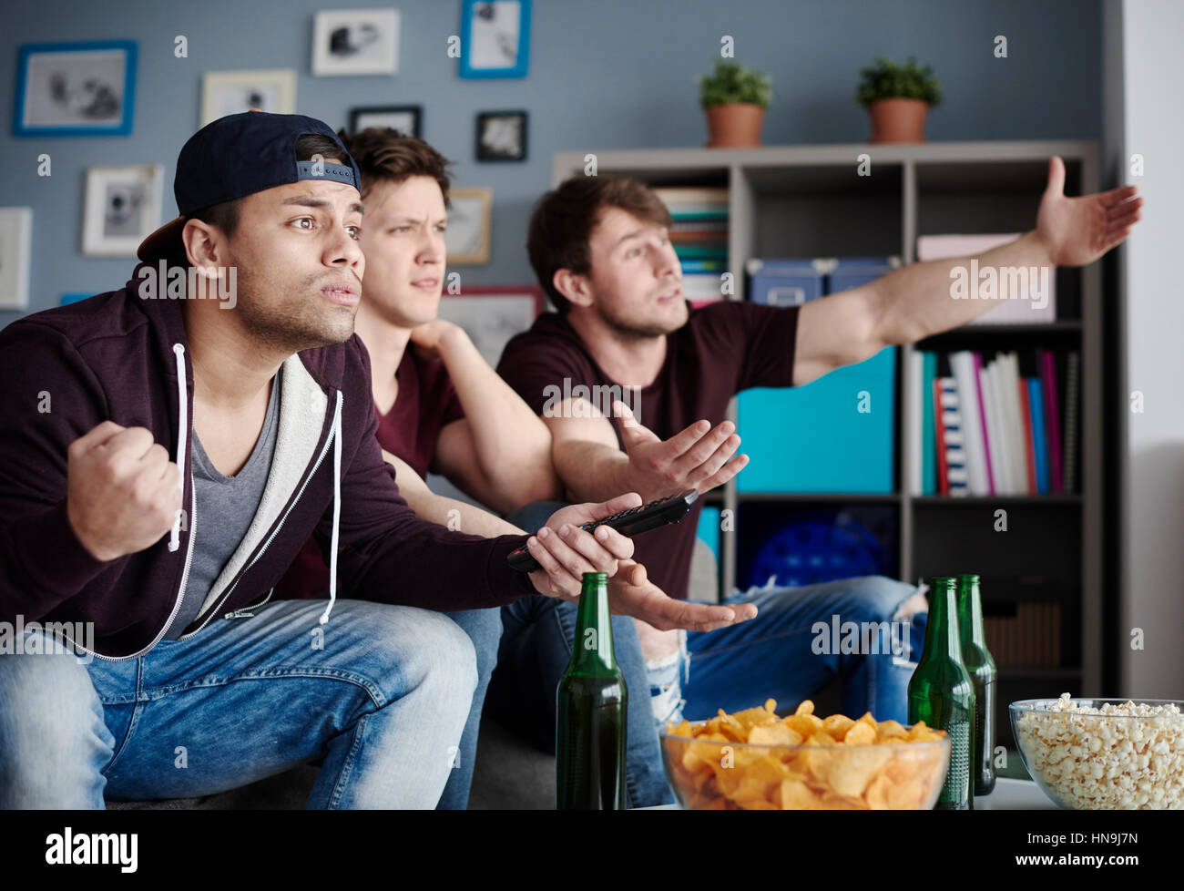 Group of friends expressing their emotions - Stock Image