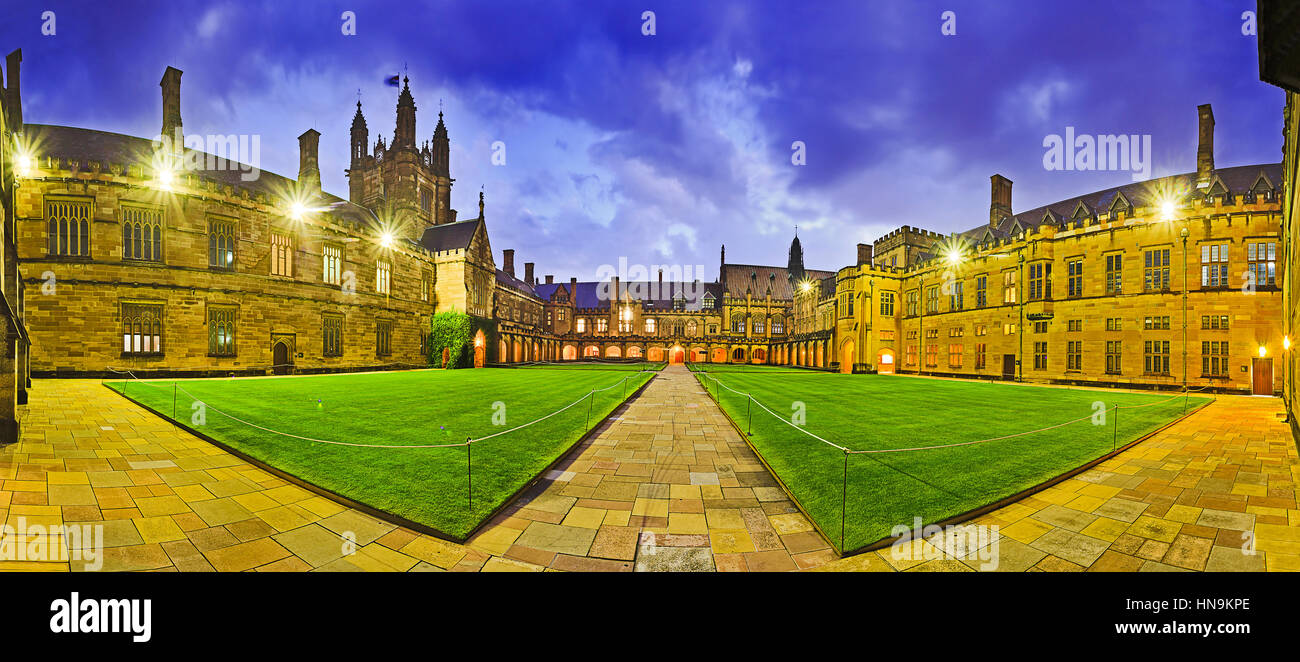 Australian tertiary education institution - university in Sydney at sunset. Panoramic courtyard of main historic - Stock Image