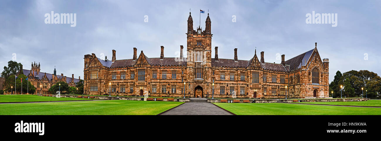 Facade of historic building in Sydney - University campus main office. Wide panorama of main entrance and gothic - Stock Image