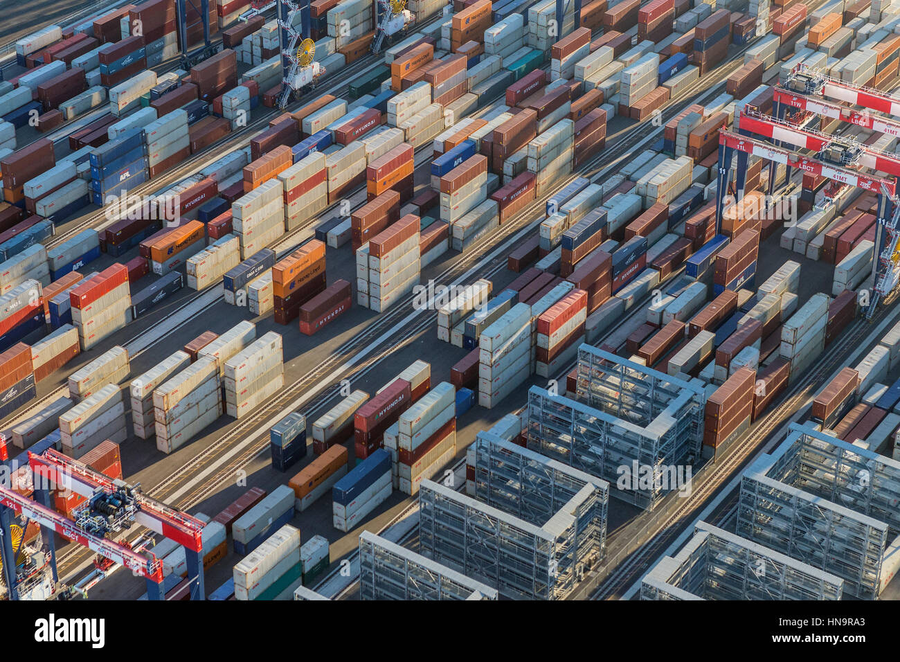 Los Angeles, California, USA - August 16, 2016:  Afternoon aerial view of cargo shipping containers stacked on docks. - Stock Image