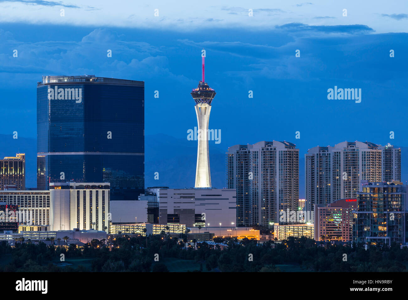 Las Vegas, Nevada, USA - June 10, 2015:  Stormy dusk sky behind the Stratosphere and Fontainebleau towers on the - Stock Image