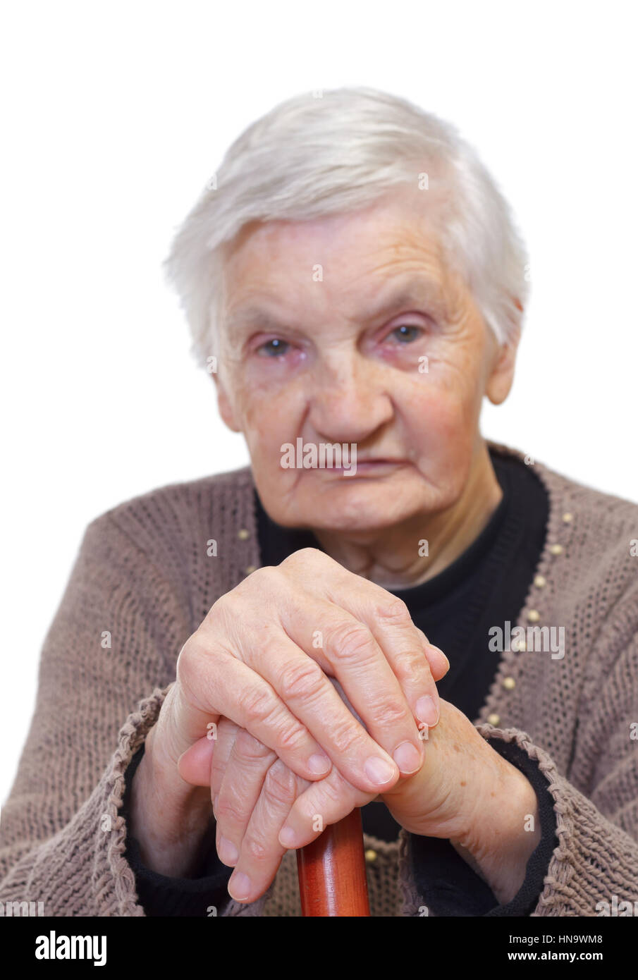 Portrait of an elderly wrinkled woman on isolated background - Stock Image
