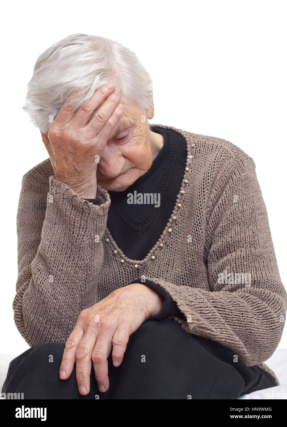 Portrait of an elderly wrinkled woman with head pain - Stock Image