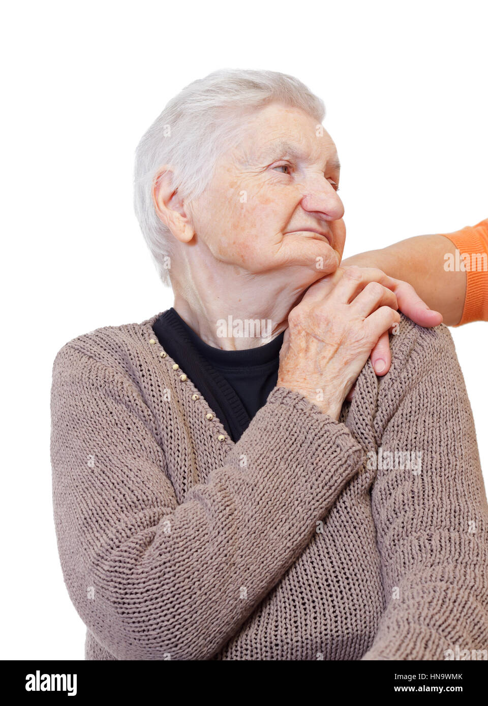 A woman hand touching an elderly shoulder - Stock Image