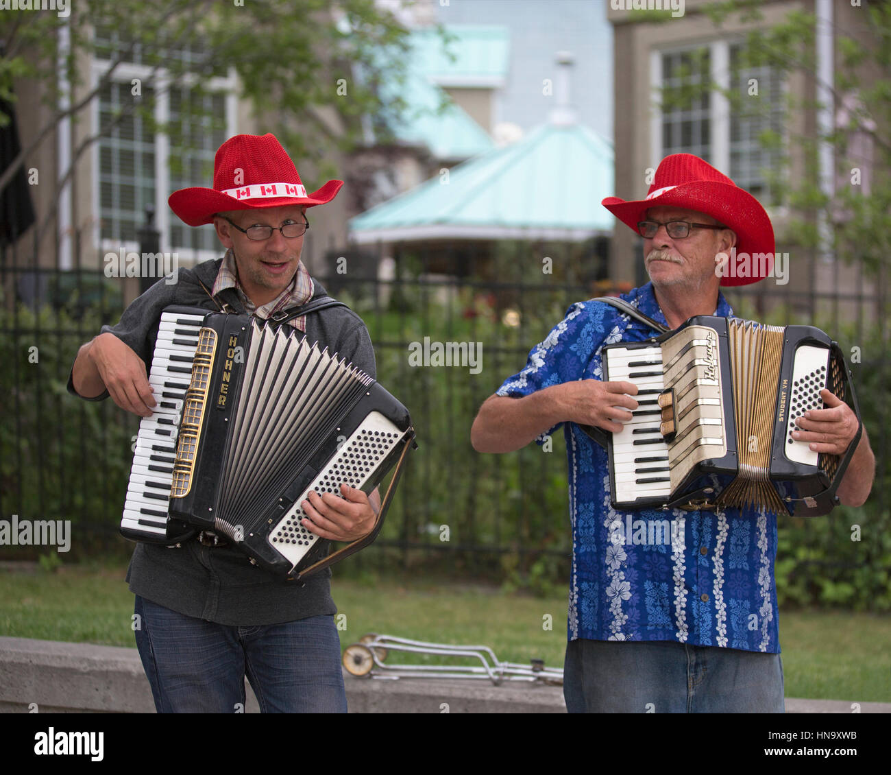 Buskerjames, street entertainers playing accordion during Canada Day celebrations in Eau Claire, downtown Calgary - Stock Image