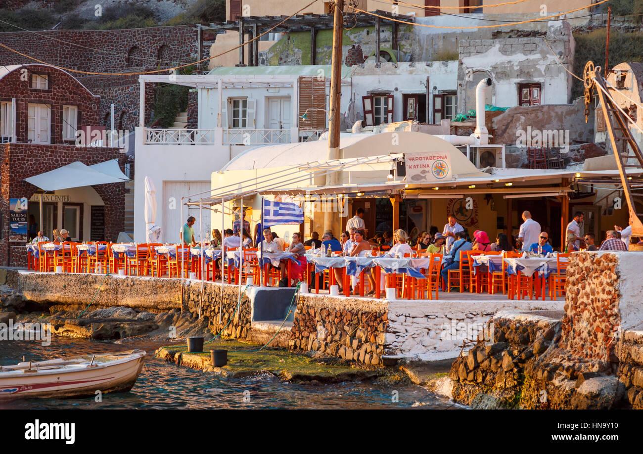 Harbourside fish restaurant 'Katina' in Ammoudi Bay, Oia, Santorini, a Mediterranean Greek Island in the - Stock Image