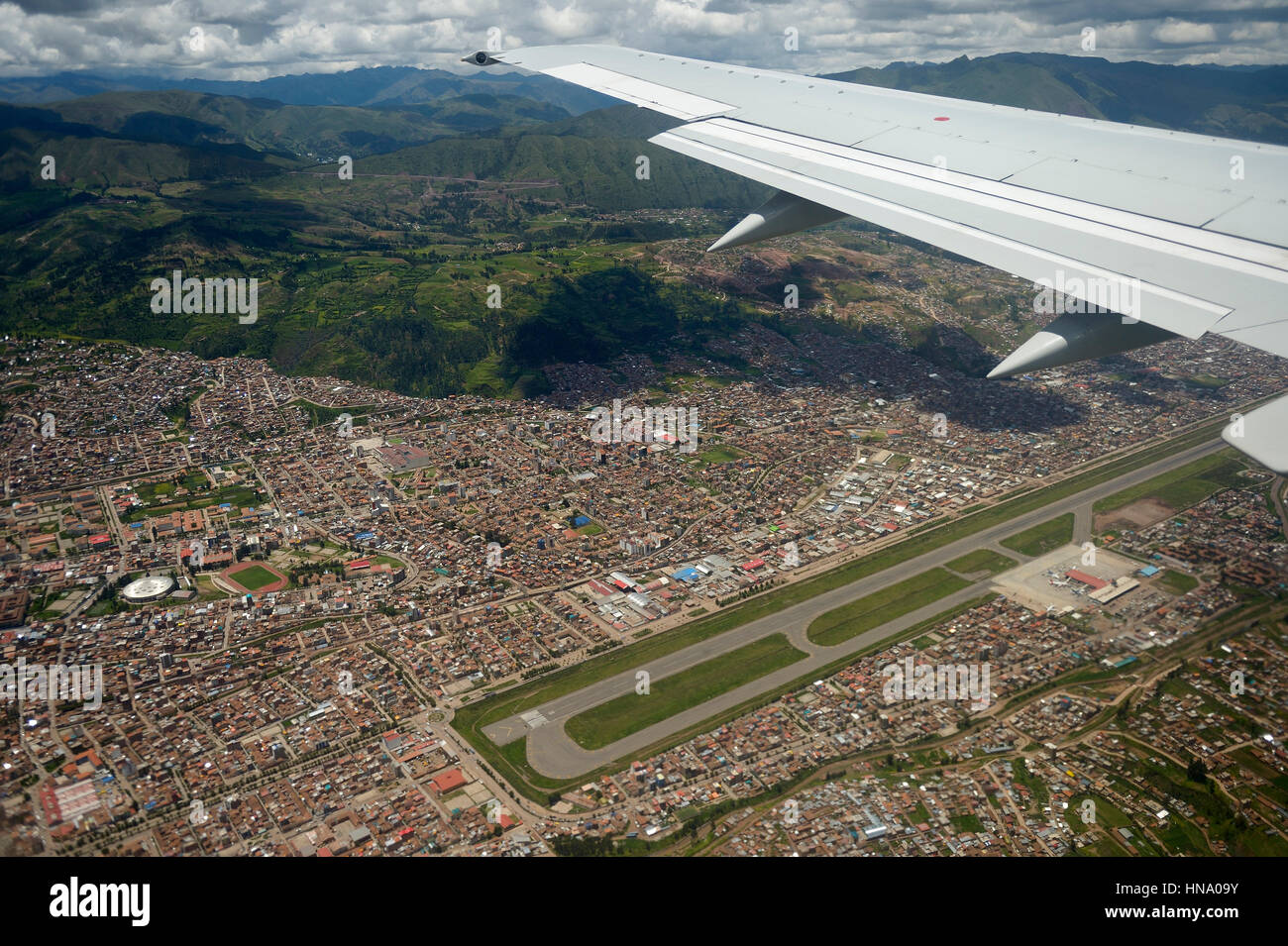 Cityscape with Andes from aircraft landing at the airport Aeropuerto Alejandro Velasco Astete, Cusco Province, Peru - Stock Image