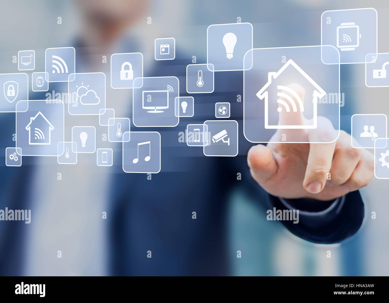 Internet of things (IOT) concept related to smart home automation and connected objects with a person touching a - Stock Image