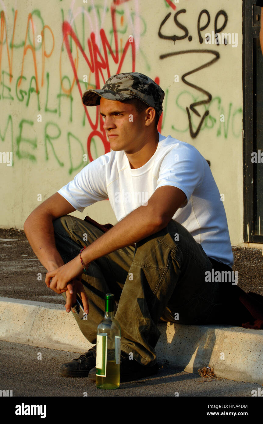 Teenager boy with a bottle of wine    Credit  © Luigi Innamorati/Sintesi/Alamy Stock Photo - Stock Image