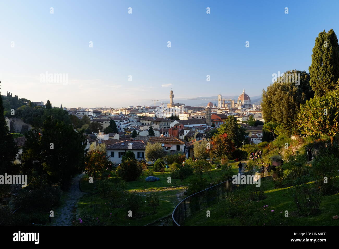Florence Skyline - Firenze skyline panoramic view from The Rose Garden (Giardino delle rose) - Daylight golden hour - Stock Image