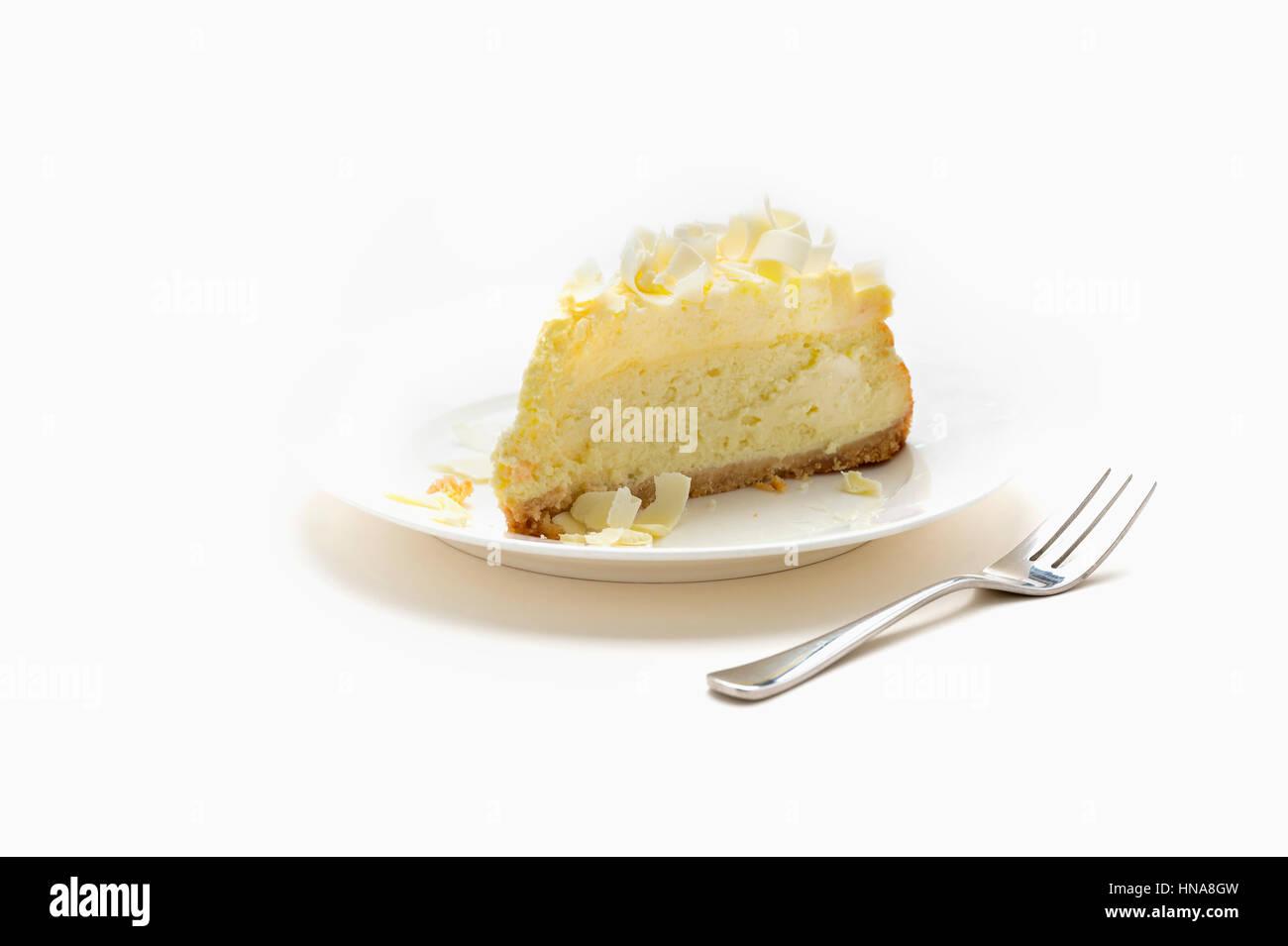 White chocolate cheese cake slice - Stock Image