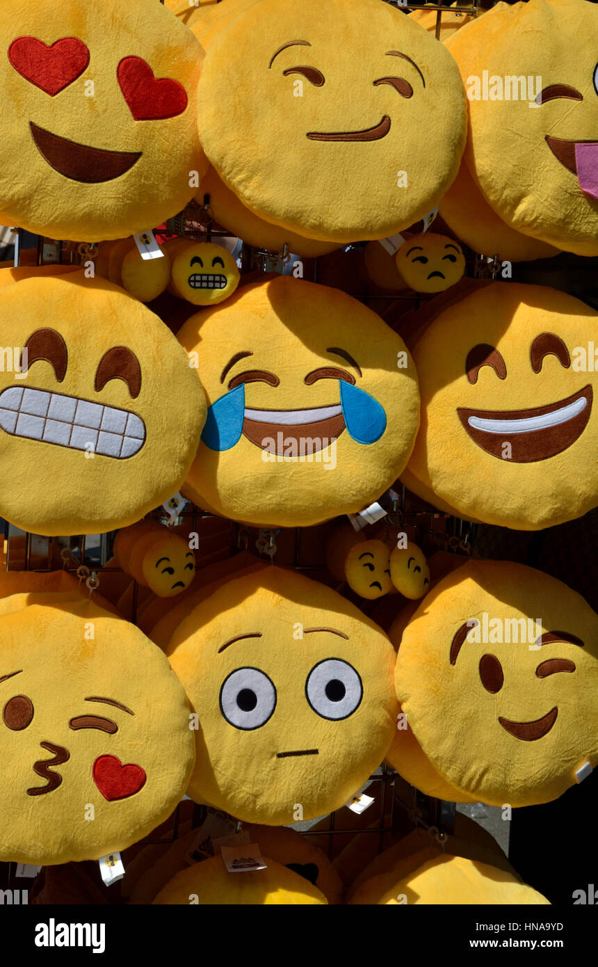 Emoji faces on a street stall - Stock Image