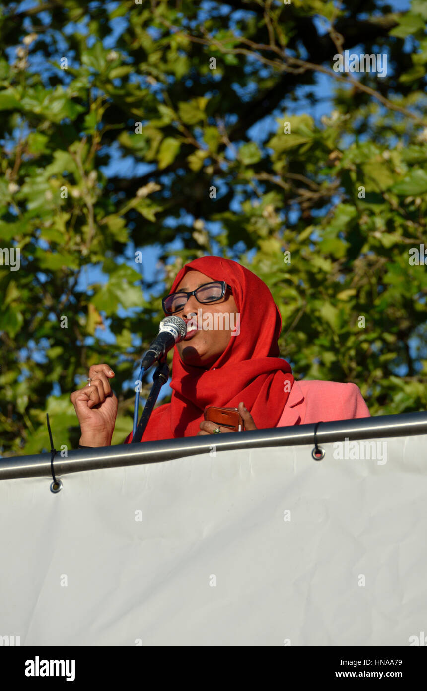 Muslim woman in hijab speaking at a political rally - Stock Image
