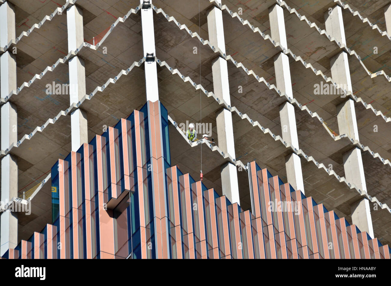 Close up of an office building under construction showing core and cladding. - Stock Image