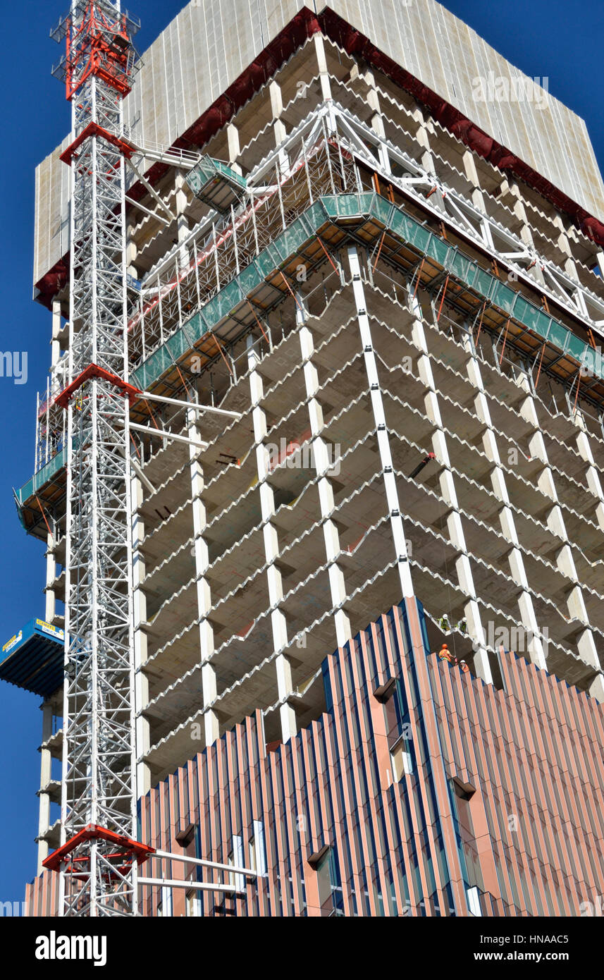 Close up of an office building tower under construction showing core and cladding. - Stock Image