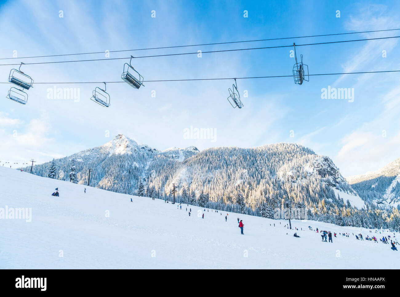 beautiful ski lift over snow mountain in ski resort with blue sky background. - Stock Image