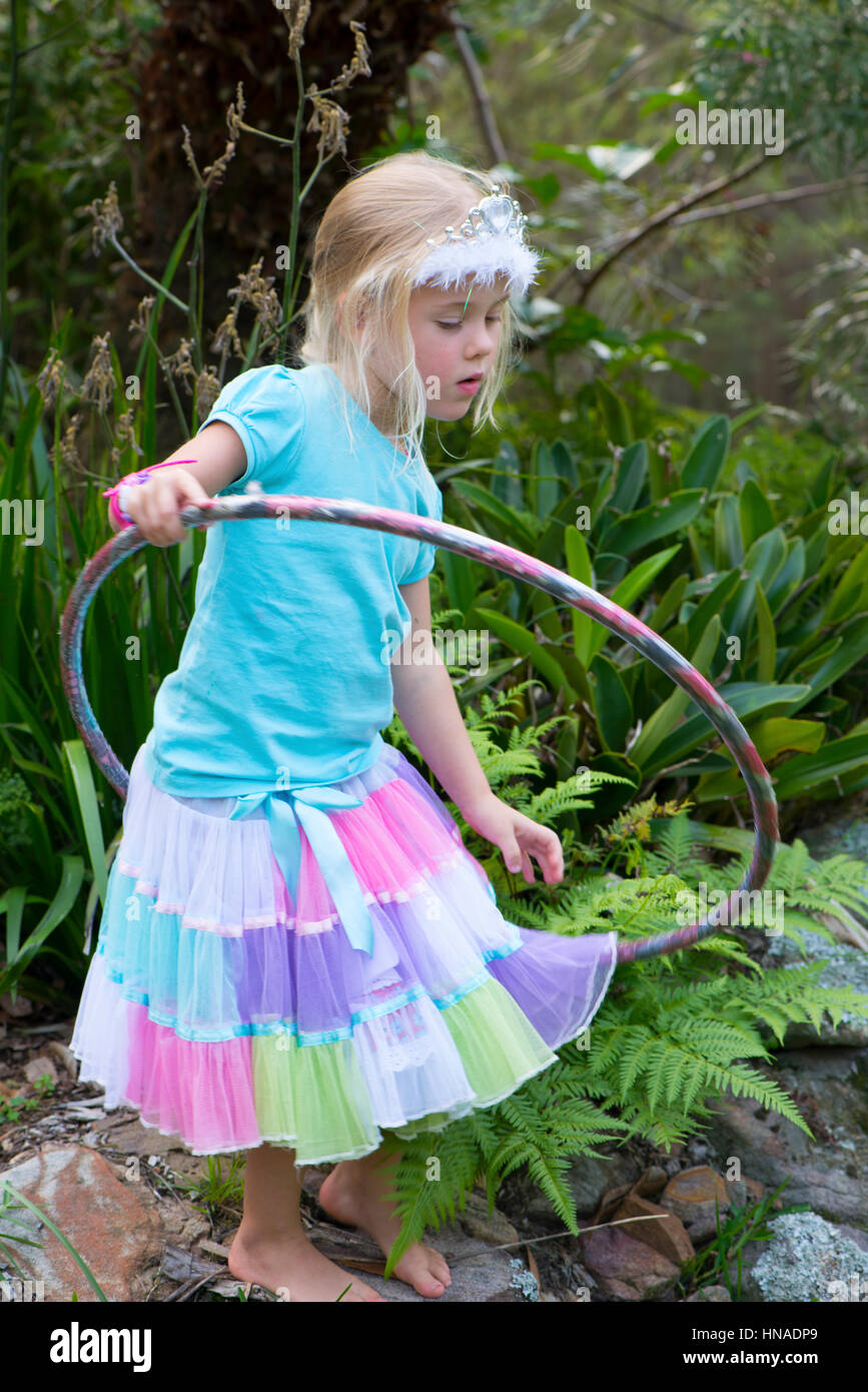 Young girl playing with a Hoola Hoop - Stock Image