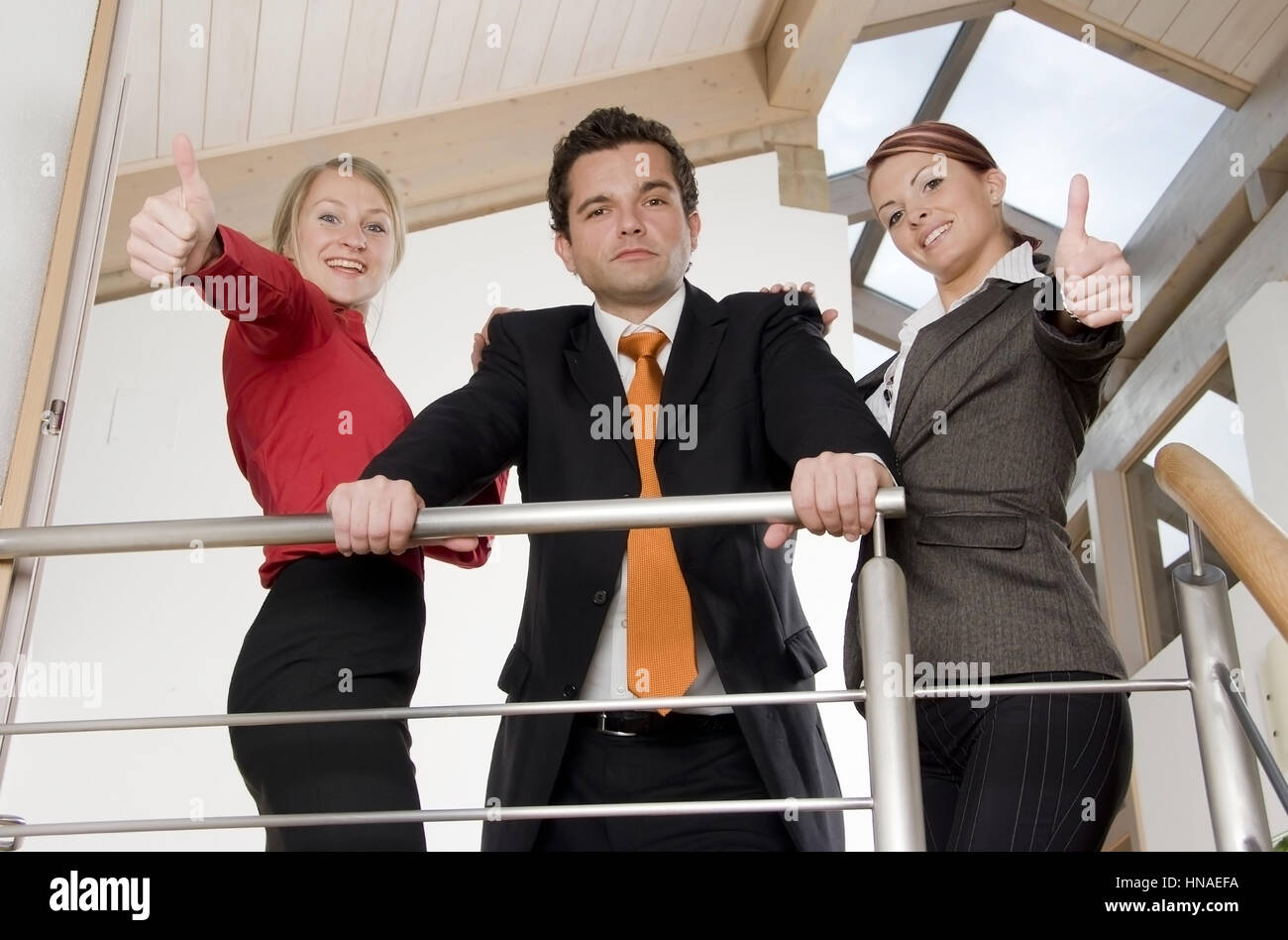 Drei junge Geschaeftsleute - three young business people - Stock Image