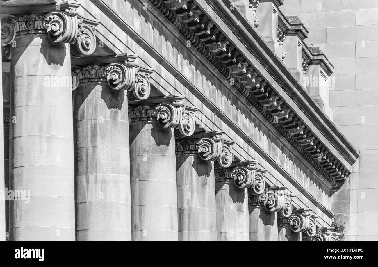 A black and white photo of a row ionic columns on the toronto power generating station in niagara falls canada