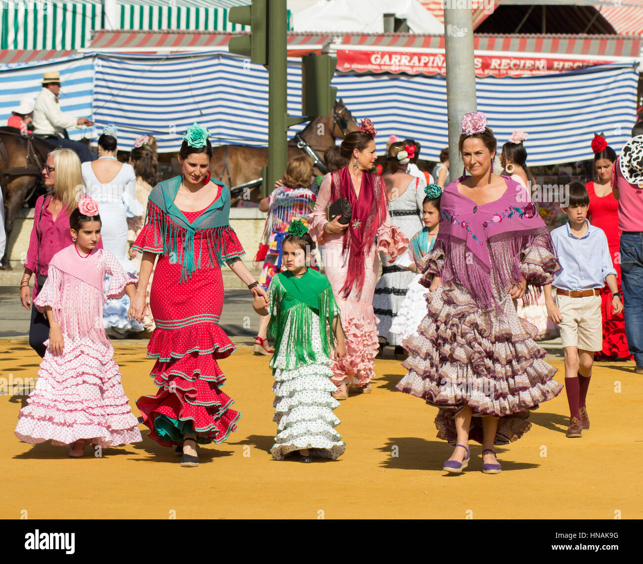 SEVILLE, SPAIN - APR, 25: women dressed in traditional costumes at the Seville's April Fair on April, 25, 2014 - Stock Image