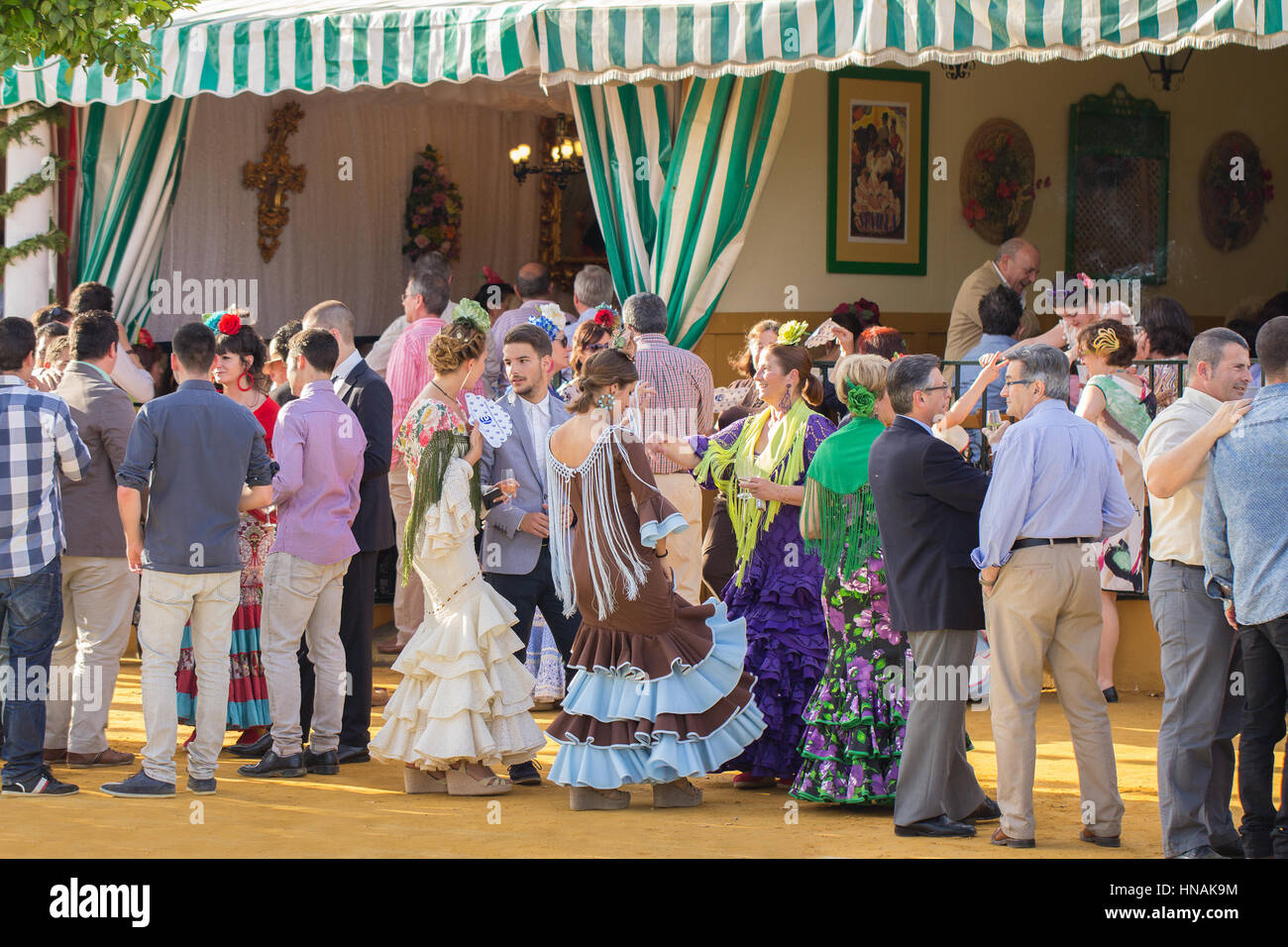 SEVILLE, SPAIN - APR, 25: people dressed in traditional spanish costumes dancing and celebrating the Seville's - Stock Image