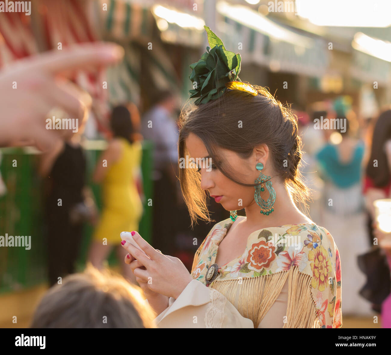 SEVILLE, SPAIN - APR, 25: woman dressed in traditional costume at the Seville's April Fair on April, 25, 2014 - Stock Image