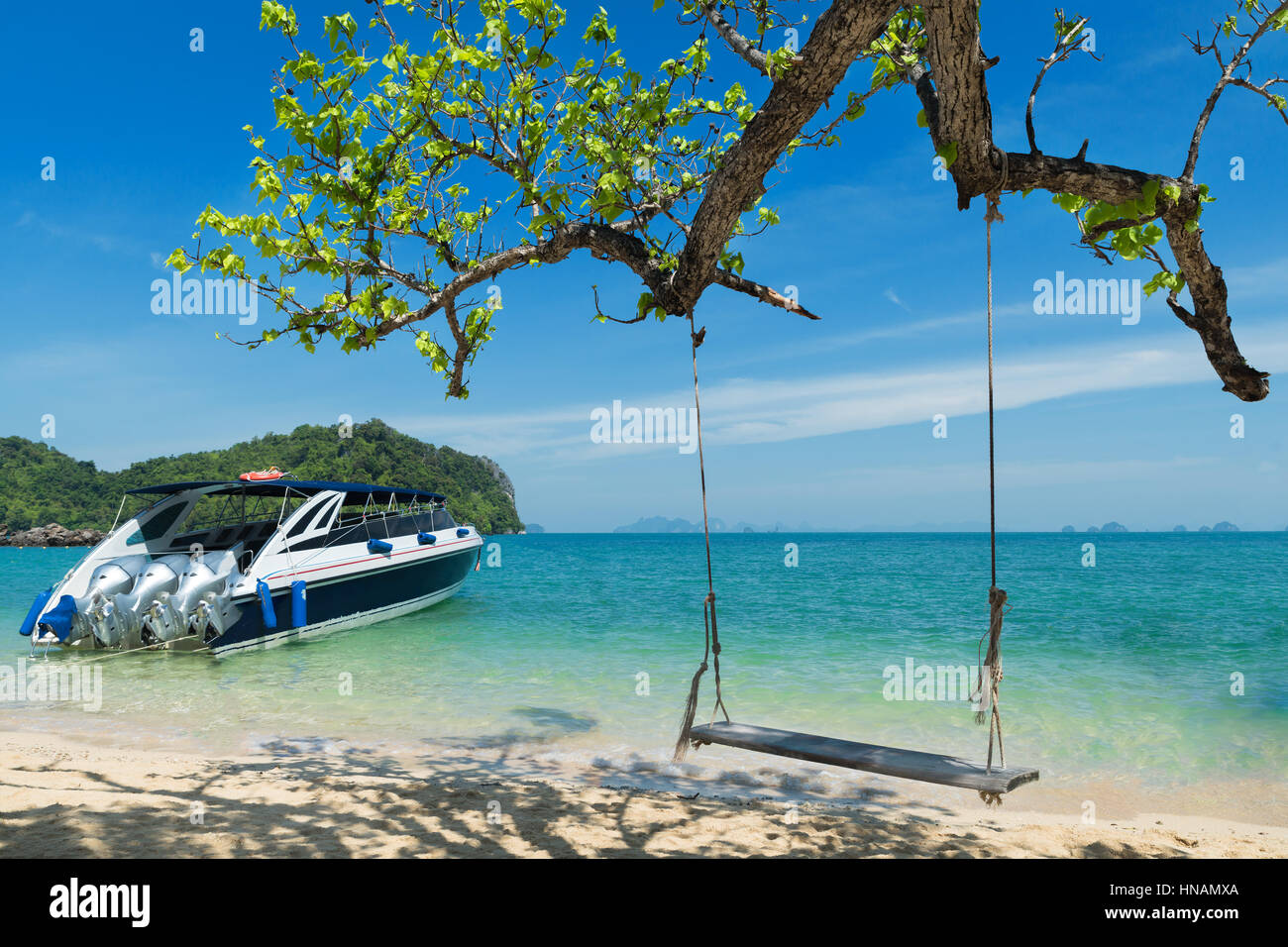 Wooden Swing Chair Hanging On Tree Near Beach At Island In