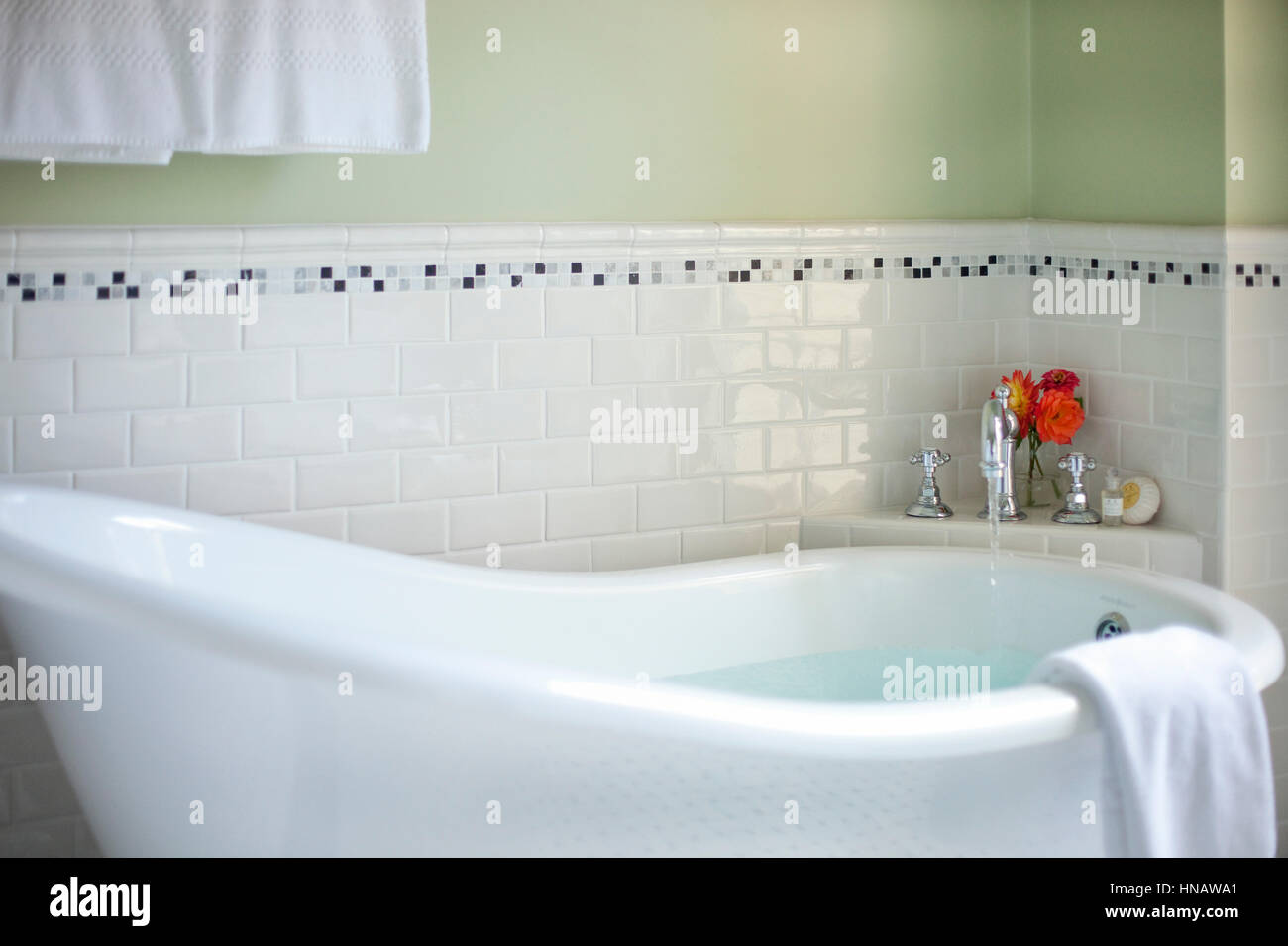 Detail of claw foot tub with faucet on, Cliffside Inn, Newport, RI. - Stock Image