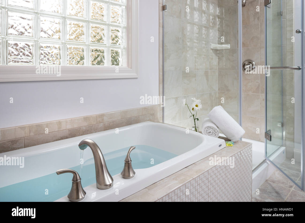 Filled Soaking Tub Next To Glass Shower, Inn On