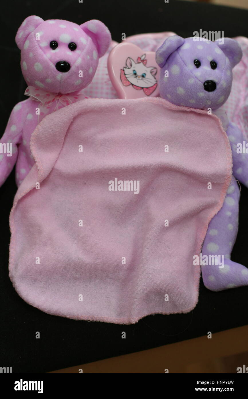 232bc6a2755 Baby girl child s pink and purple beanie bears beanie babies - Stock Image
