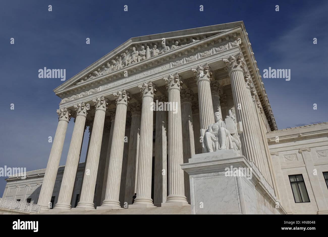 U.S. Supreme Court Building low angle.  'Equal Justice Under Law' engraved above; Authority of Law statue - Stock Image