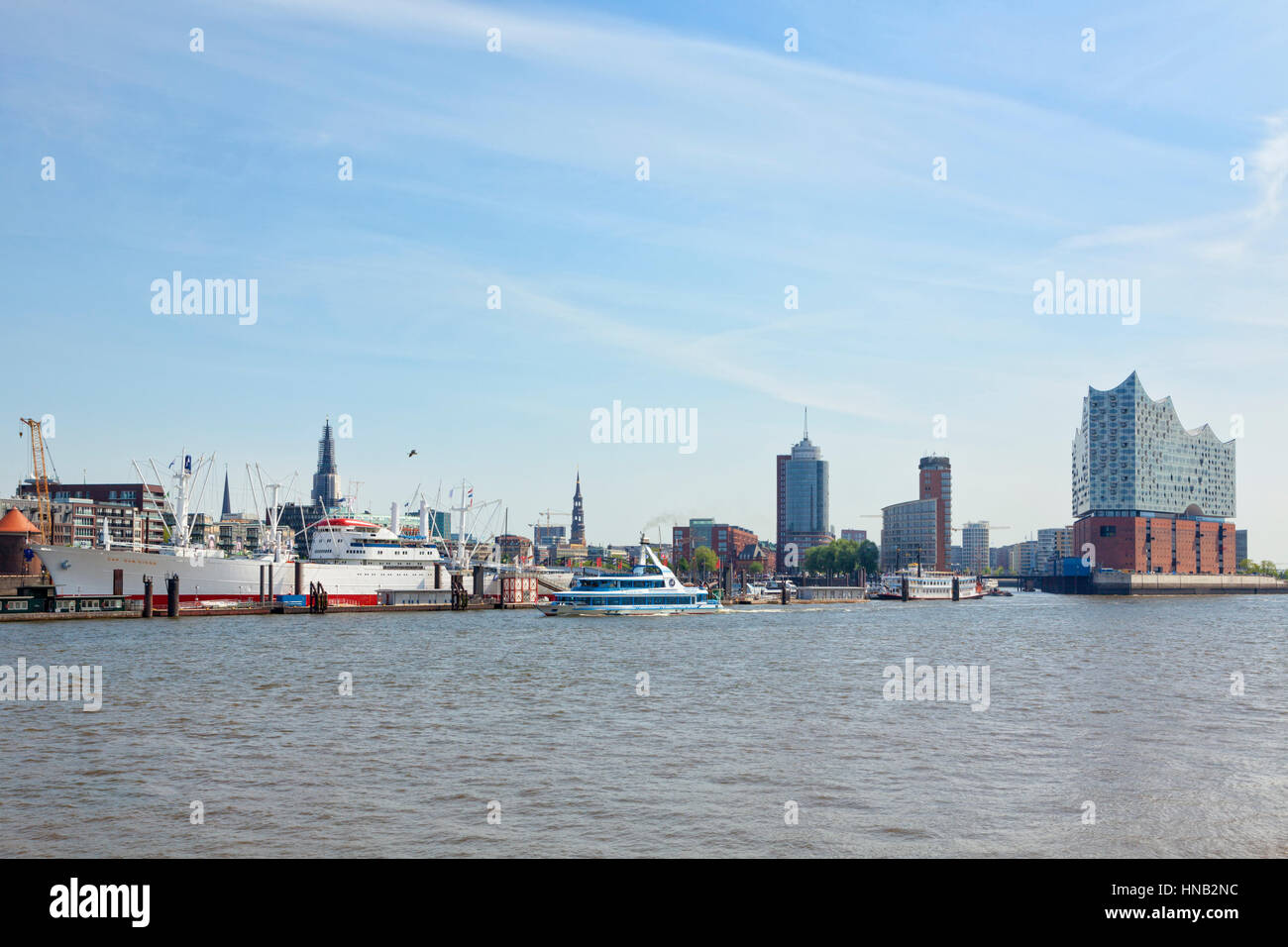 Hamburg, Germany - May 19, 2016: Waterfront from St pauli piers with museum ship Cap San Diego to HafenCity quarter - Stock Image