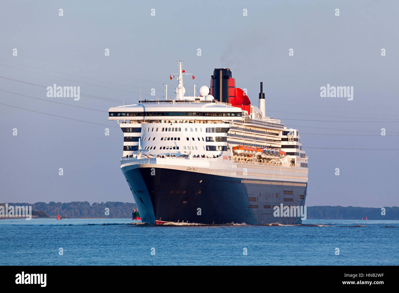Stade, Germany - August 30, 2016: Luxury cruise ship RMS Queen Mary 2 on Elbe river heading to Southampton. - Stock Image