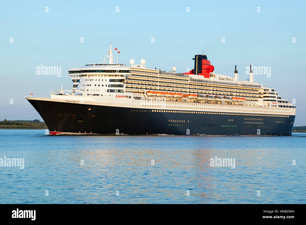 Stade, Germany - August 30, 2016: Luxury cruise liner RMS Queen Mary 2 departing from Hamburg to Southampton on Stock Photo