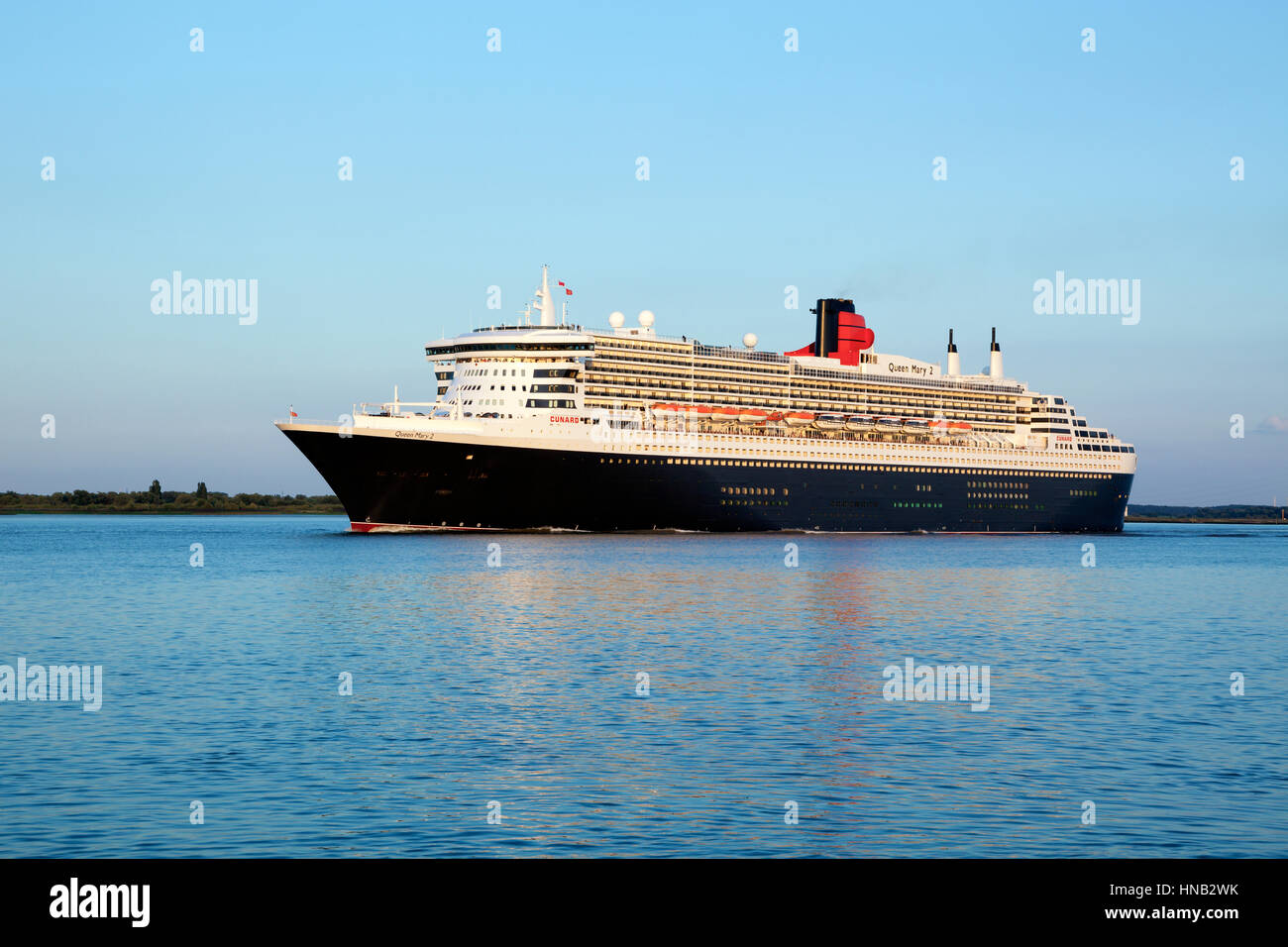 Stade, Germany - August 30, 2016: Luxury cruise liner RMS Queen Mary 2 departing from Hamburg to Southampton on - Stock Image