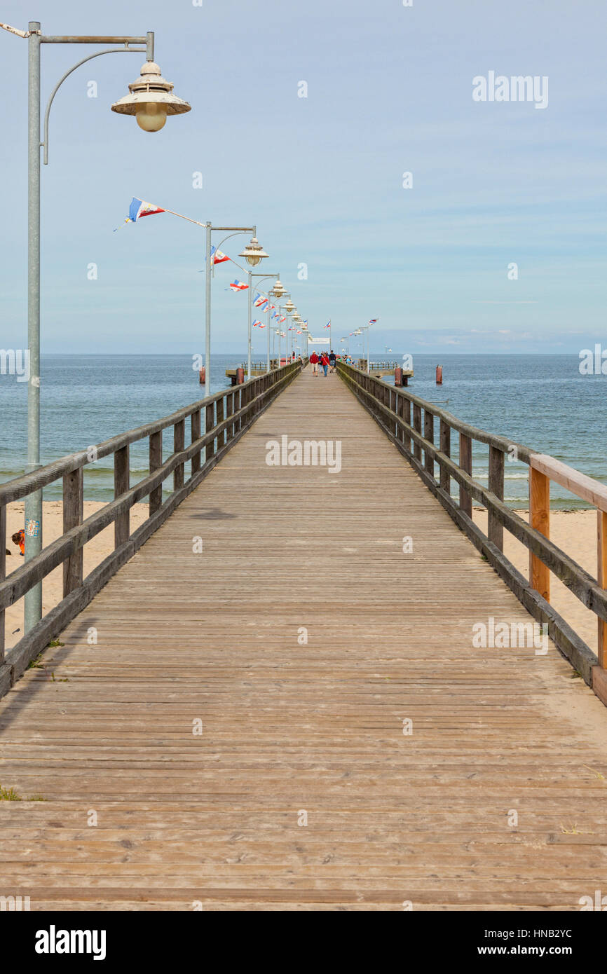Göhren, Germany - September 22, 2016: The wooden pier at the Baltic Sea beach on a  late summer day. The structure - Stock Image