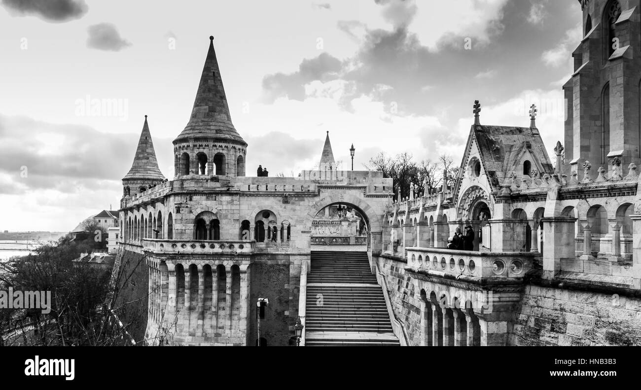 A monochrome edited image looking through a look-out point in Fishermans Bastion.  This beautiful terrace sits part - Stock Image