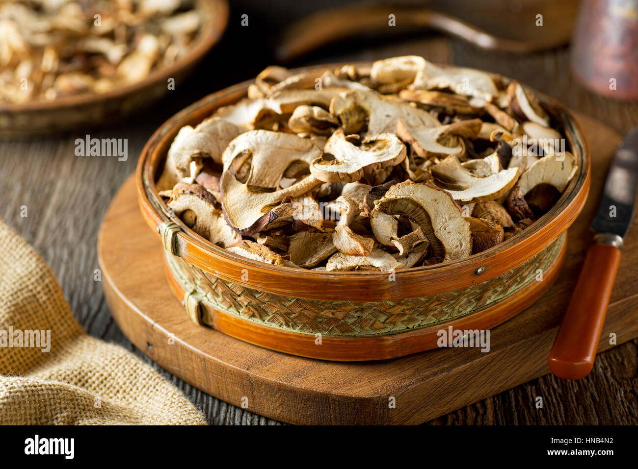 Sliced and dried wild mushrooms in a basket. - Stock Image