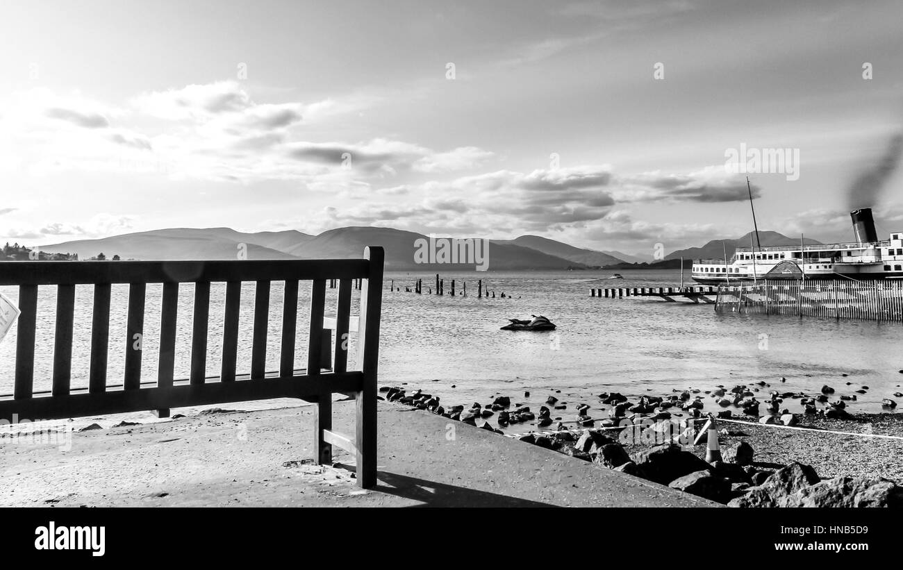 Empty bench on Beautiful Landscape of Loch Lomond of Scotland during Summer time Stock Photo