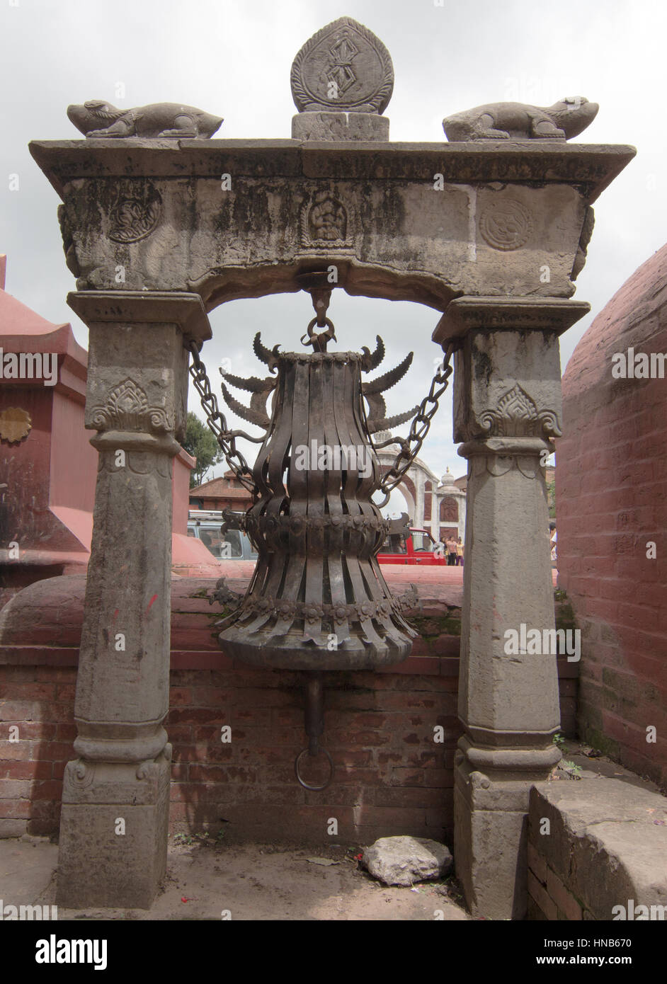 Stylised brass bell outside a Hindu temple in Bhaktapur, Kathmandu, used  for religious ceremonies - Stock Image