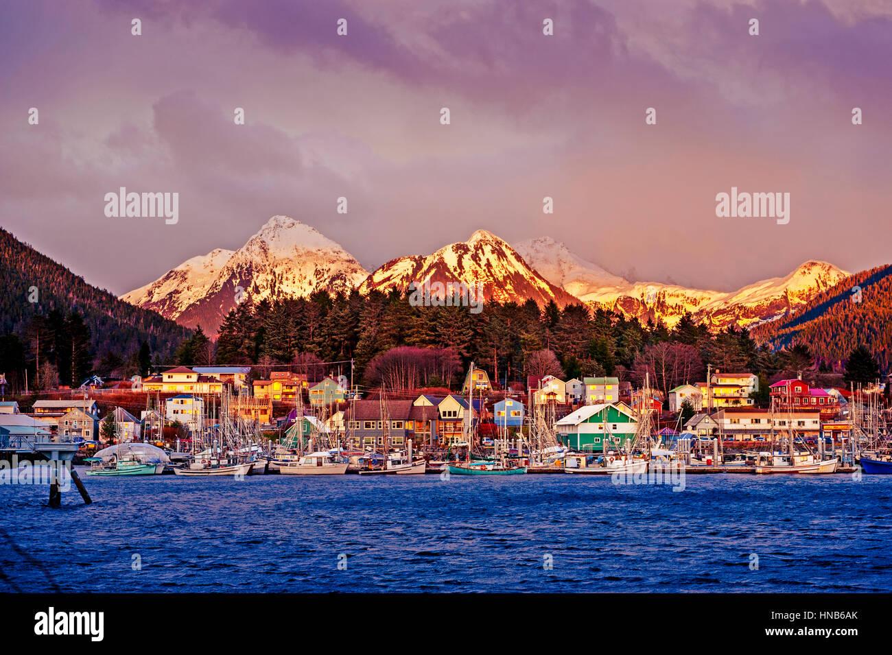Alaska Native Brotherhood, ANB Harbor and the Sisters mountains at sunset, downtown Sitka, Alaska, USA.  Photography - Stock Image