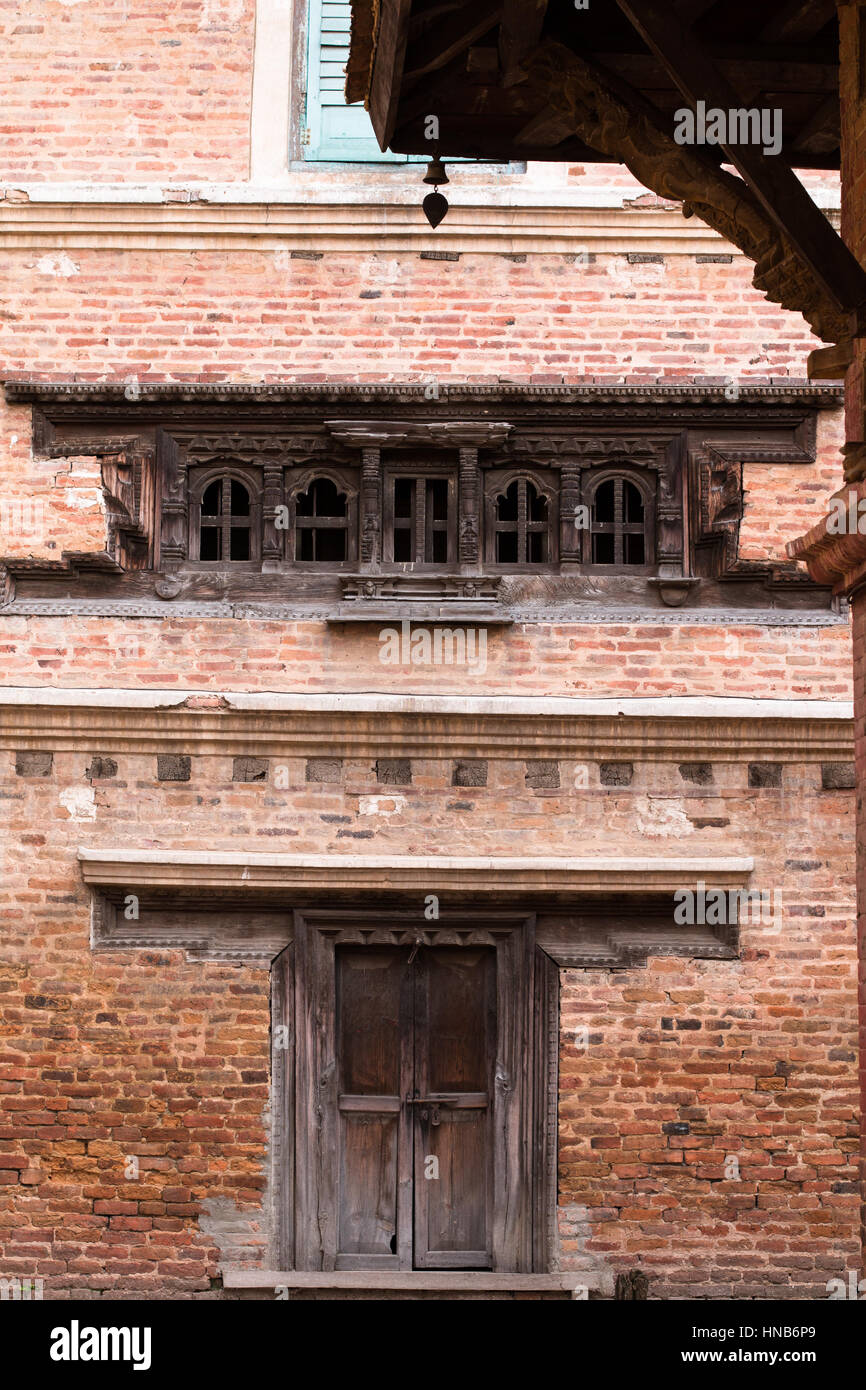 The wall, the window and the door, in an old house in Kathmandu built in traditional Nepali style - Stock Image